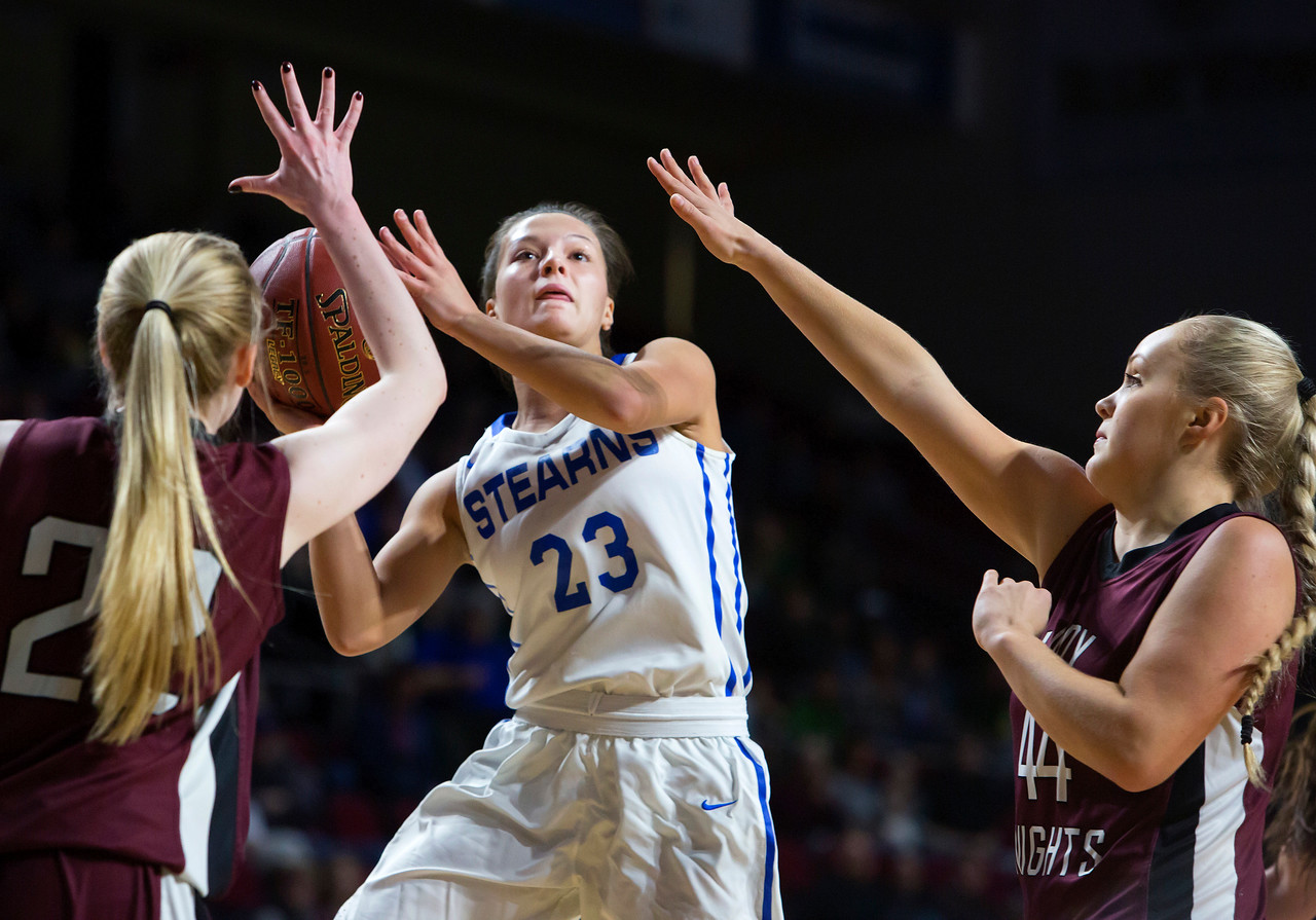 BANGOR, Maine -- 02/21/2017 -- Stearns' Emma Alley (center) tries for two past Narraguagus' Kayla Toppin (left) and Narraguagus' Kaci Alley during their Class C girls basketball quarterfinal game at the Cross Insurance Center in Bangor Tuesday. Ashley L. Conti | BDN