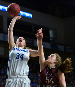 BANGOR, Maine -- 02/21/2017 -- Stearns' Mackenzie Carter (left) is fouled by Narraguagus' Kylee Joyce during their Class C girls basketball quarterfinal game at the Cross Insurance Center in Bangor Tuesday. Ashley L. Conti | BDN