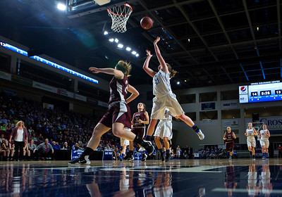 BANGOR, Maine -- 02/21/2017 -- Stearns' Peighton Ingersoll (center) is fouled trying for two by Narraguagus' Kirstin Kennedy during their Class C girls basketball quarterfinal game at the Cross Insurance Center in Bangor Tuesday. Ashley L. Conti | BDN