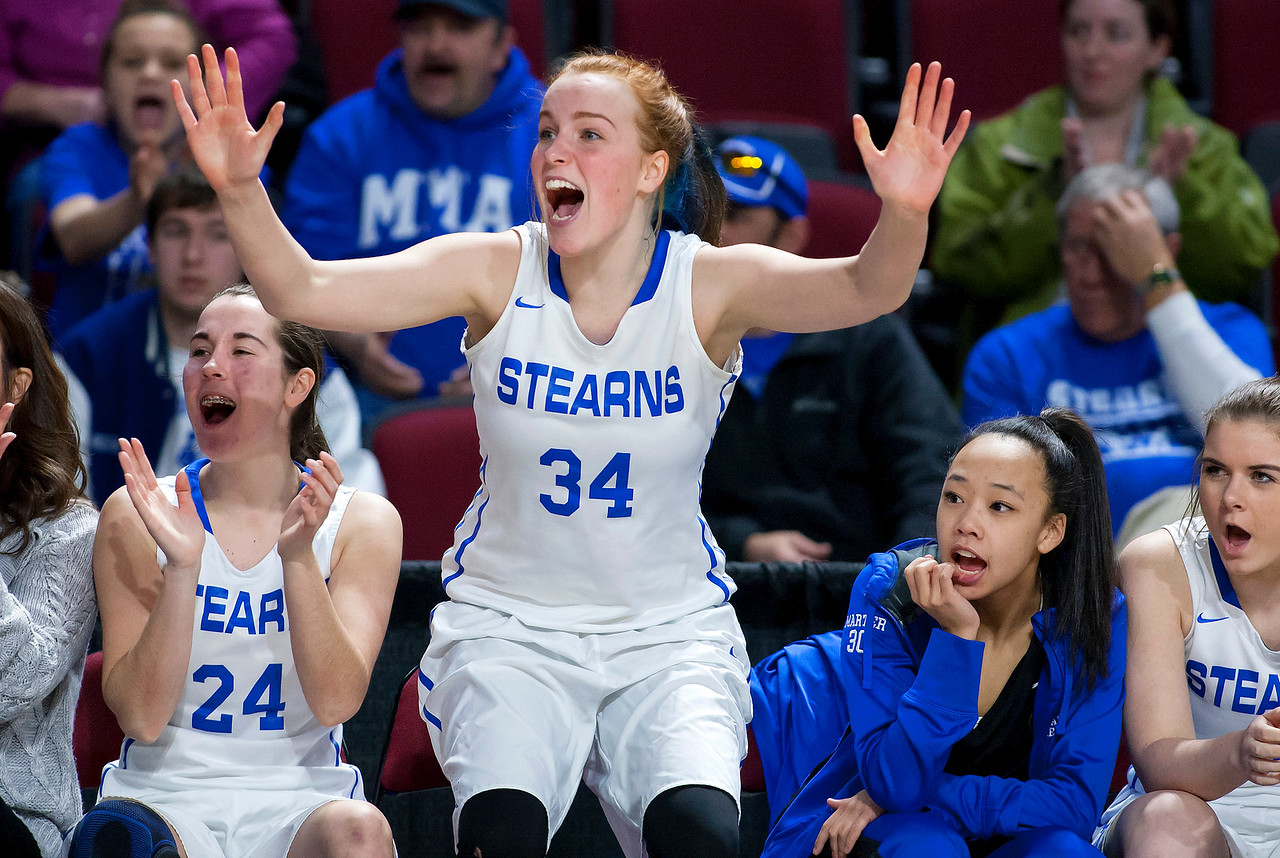 BANGOR, Maine -- 02/21/2017 -- Stearns' Mackenzie Carter (center) celebrates as after her team scored against Narraguagus during their Class C girls basketball quarterfinal game at the Cross Insurance Center in Bangor Tuesday. Ashley L. Conti   BDN