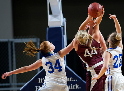 BANGOR, Maine -- 02/21/2017 -- Narraguagus' Kaci Alley (center) is fouled by Stearns' Mackenzie Carter during their Class C girls basketball quarterfinal game at the Cross Insurance Center in Bangor Tuesday. Ashley L. Conti | BDN