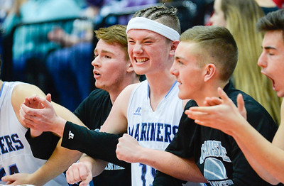 Jack Lombardo celebrates a late in the game free throw during Oceanside's Class A North match-up against Cony Wednesday in Augusta. The Mariners won 67-61 and moved onto the regional final on Friday.