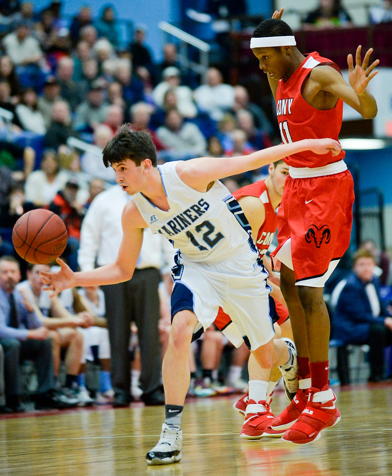 The Mariners' Sam Atwood is able to break away from Amahde Carter and regain control of the ball in a failed steal attempt during the first quarter of the Class A North Semifinal Wednesday. Oceanside won in a close 67-61 game.