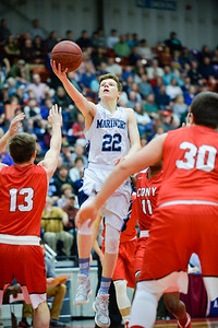 Cooper Wirkala makes a two-point basket during the first quarter of the Class A North Semifinal Wednesday. Oceanside bested Cony 67-61.