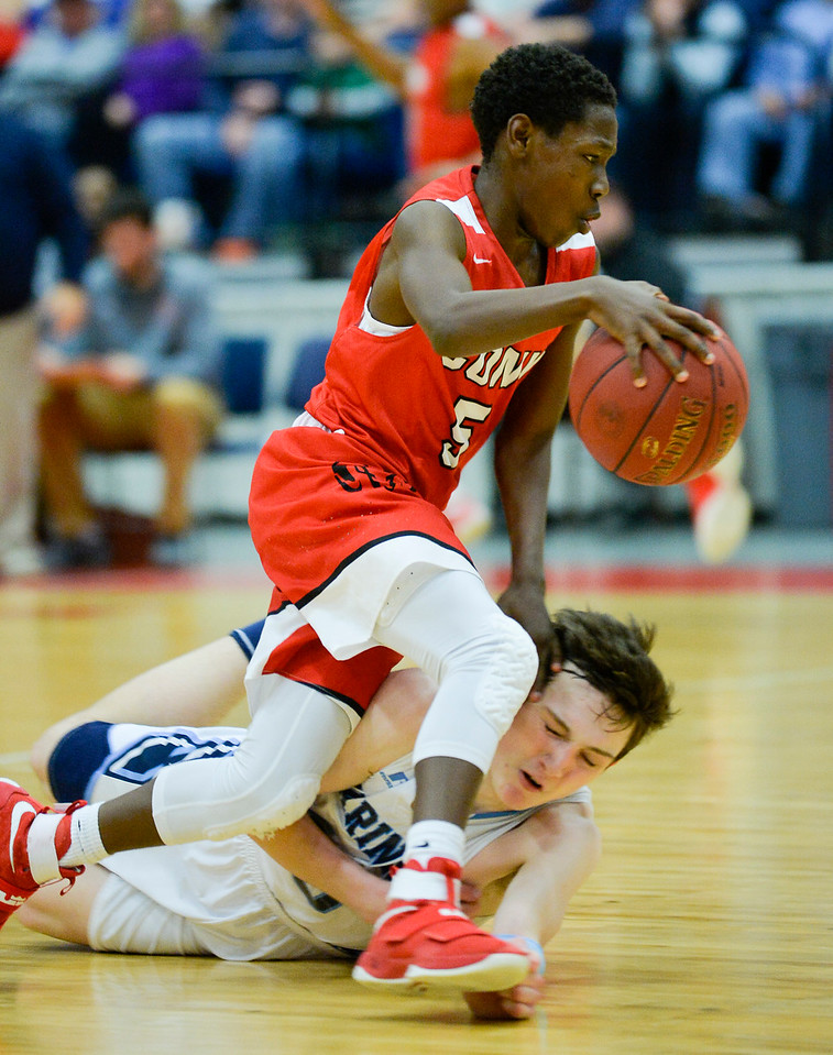 Michael Norton Jr. gets ran over by Simon McCormick after a brief fight for the ball in the second half of the Class A North Semifinal Wednesday. Oceanside won 67-61.