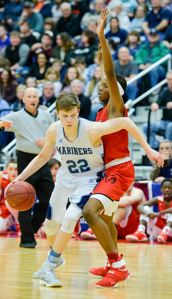 Cooper Wirkala maneuvers around Amahde Carter during the second half of the Class A North Semifinal Wednesday.