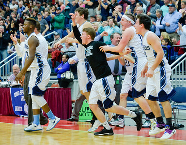 The Oceanside Mariners celebrate their close 67-61 win over Cony Rams in the Class A North Semifinal Werdnesday at the Augusta Civic Center.