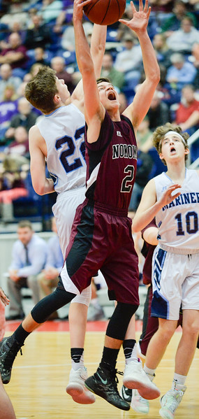 Joshua Smestad from Nokomis nabs the rebound past Oceanside's Cooper Wirkala, left, and Jack Lombardo in the first half of their Class A North Quarterfinal Saturday in Augusta.