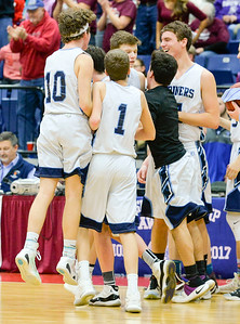 Oceanside celebrates their 53-49 win over Nokomis Saturday in Augusta.