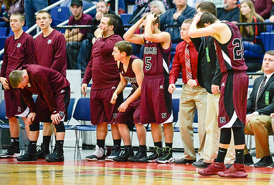 Nokomis bench reacts to foul late in the Class A North Quarterfinal  against Oceanside Saturday in Augusta. The game was close each quarter, but Oceanside prevailed 53-49.