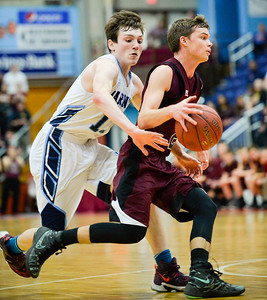Oceanside's Michael Norton, Jr., attempts to slap the ball away from Joshua Smestad in the second quarter of their Class A North Quarterfinal Saturday in Augusta.
