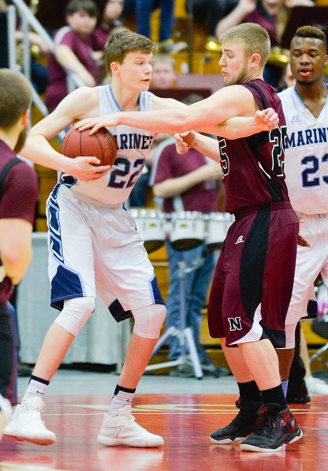 Oceanside's Cooper Wirkala and Nokomis' Brad Allen tussle over a rebound late in the Class A North Quarterfinal Saturday in Augusta.