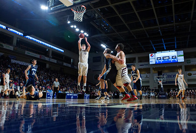 BANGOR, Maine -- 02/18/2017 -- Orono's Connor Robertson (center) puts up a jumper for two past Presque Isle during their Class B boys basketball quarterfinal game at the Cross Insurance Center in Bangor Saturday. Ashley L. Conti | BDN