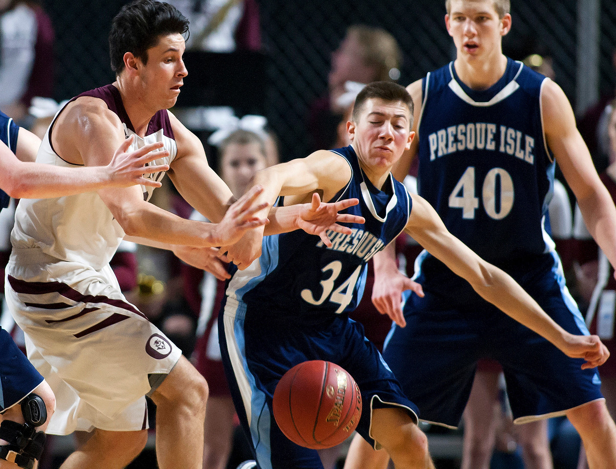 BANGOR, Maine -- 02/18/2017 -- Presque Isle's Jonah G. Hudson (right) steals the ball from Orono's Nate Desisto during their Class B boys basketball quarterfinal game at the Cross Insurance Center in Bangor Saturday. Ashley L. Conti | BDN