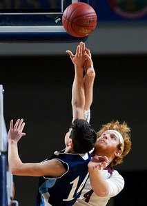 BANGOR, Maine -- 02/18/2017 -- Orono's Jackson Coutts (right) fouls Presque Isle's Griffin P. Guerrete during their Class B boys basketball quarterfinal game at the Cross Insurance Center in Bangor Saturday. Ashley L. Conti | BDN