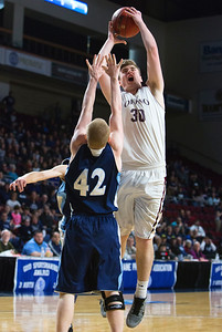 BANGOR, Maine -- 02/18/2017 -- Orono's Connor Robertson (right) drives up for two past Presque Isle's Jason M. Dumais during their Class B boys basketball quarterfinal game at the Cross Insurance Center in Bangor Saturday. Ashley L. Conti | BDN