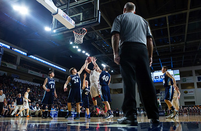 BANGOR, Maine -- 02/18/2017 -- Orono's Jake Koffman (center) goes up for two past Presque Isle's Jacob J. Kinney (left) and Presque Isle's Bradley R. Kinney during their Class B boys basketball quarterfinal game at the Cross Insurance Center in Bangor Saturday. Ashley L. Conti | BDN