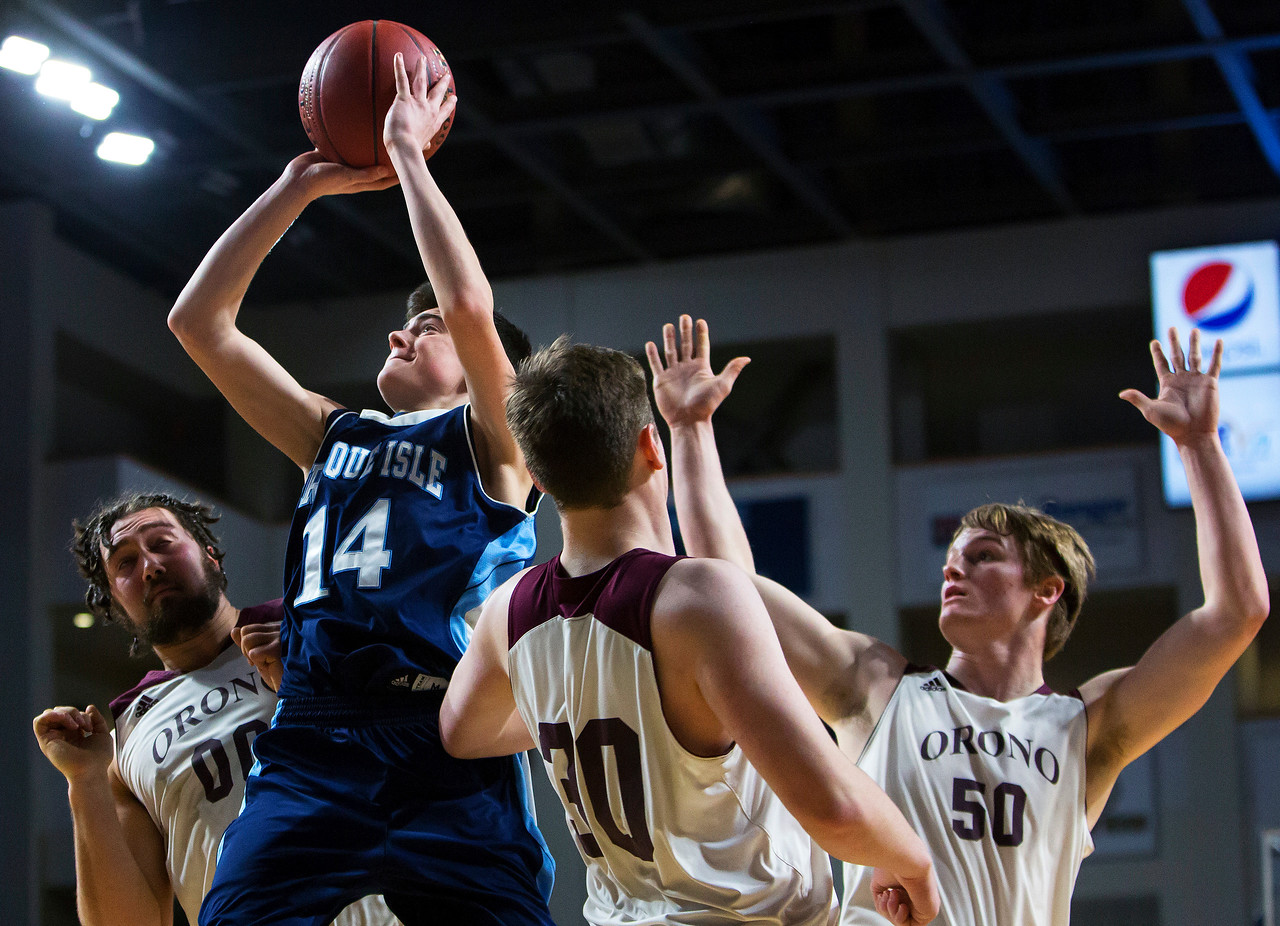 BANGOR, Maine -- 02/18/2017 -- Presque Isle's Griffin P. Guerrete (center) drives up to the basket past Orono's Jake Koffman (left), Orono's Connor Robertson and Orono's Keenan Collett during their Class B boys basketball quarterfinal game at the Cross Insurance Center in Bangor Saturday. Ashley L. Conti   BDN
