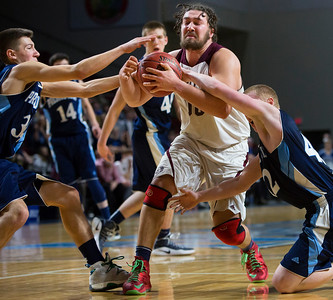 BANGOR, Maine -- 02/18/2017 -- Presque Isle's Jonah G. Hudson (left) and Presque Isle's Jason M. Dumais (right) battle for a loose ball against Orono's Jake Koffman during their Class B boys basketball quarterfinal game at the Cross Insurance Center in Bangor Saturday. Ashley L. Conti | BDN