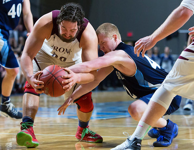 BANGOR, Maine -- 02/18/2017 -- Orono's Jake Koffman (left) battles for a loose ball against Presque Isle's Jason M. Dumais during their Class B boys basketball quarterfinal game at the Cross Insurance Center in Bangor Saturday. Ashley L. Conti | BDN