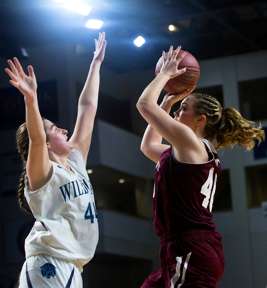 BANGOR, Maine -- 02/22/2017 -- Foxcroft Academy's Abigail Simpson (right) goes up for two past Presque Isle's Skylar J. Vogel during their Class B girls basketball semifinal game at the Cross Insurance Center in Bangor Wednesday. Ashley L. Conti | BDN