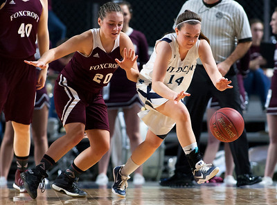 BANGOR, Maine -- 02/22/2017 -- Presque Isle's Emily A. Wheaton (right) steals the ball from Foxcroft Academy's Kendra Ewer during their Class B girls basketball semifinal game at the Cross Insurance Center in Bangor Wednesday. Ashley L. Conti | BDN