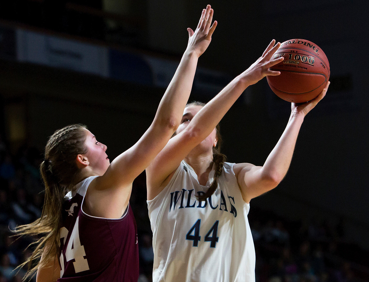 BANGOR, Maine -- 02/22/2017 -- Presque Isle's Skylar J. Vogel (right) tries for two past Foxcroft Academy's Mackenzie Beaudry during their Class B girls basketball semifinal game at the Cross Insurance Center in Bangor Wednesday. Ashley L. Conti | BDN