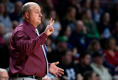 BANGOR, Maine -- 02/22/2017 -- Foxcroft Academy head coach Blake Smith holds up a play during their Class B girls basketball semifinal game against Presque Isle at the Cross Insurance Center in Bangor Wednesday. Ashley L. Conti | BDN