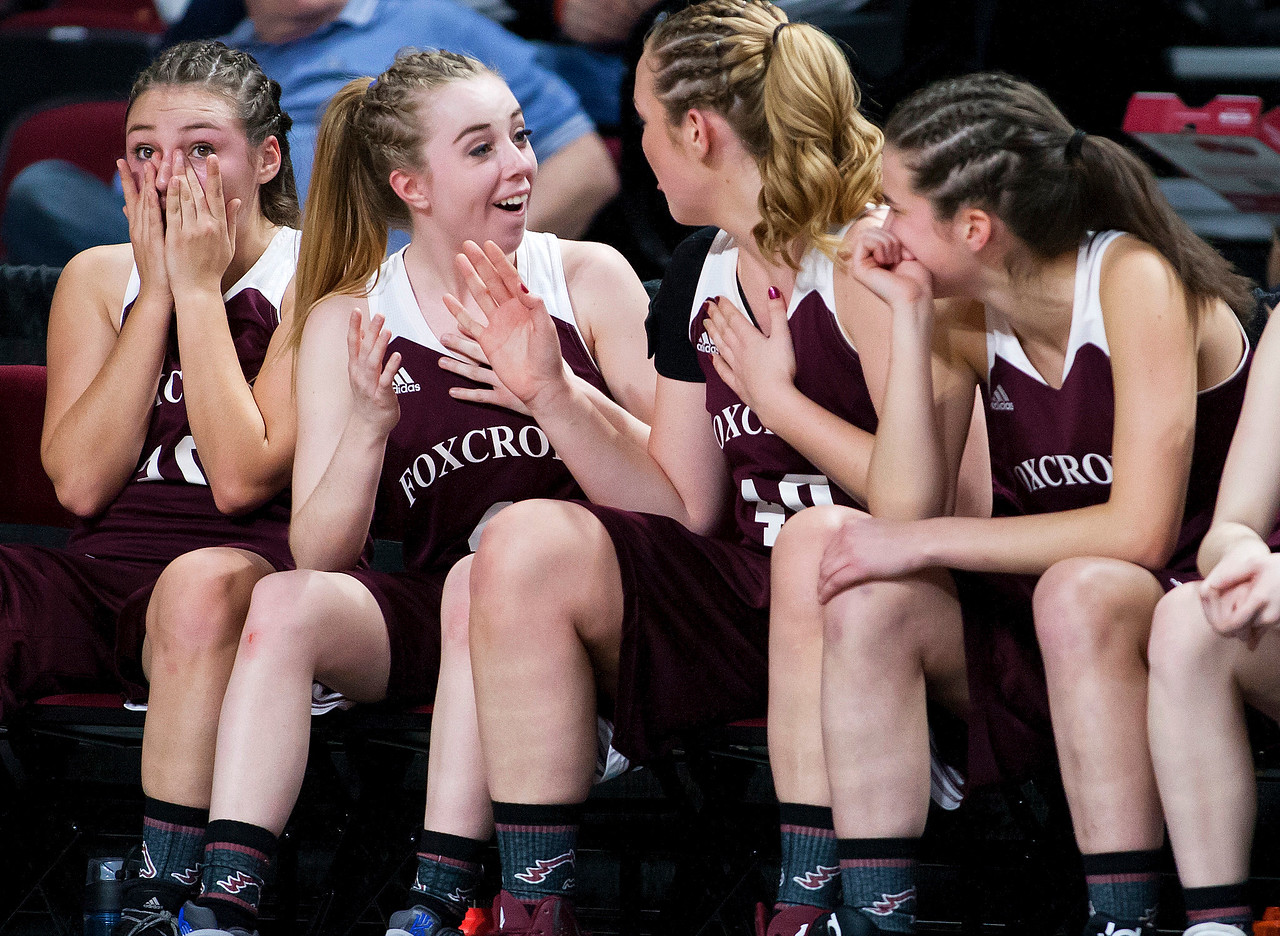 BANGOR, Maine -- 02/22/2017 -- The Foxcroft Academy bench celebrates as they realize they will take the win during their Class B girls basketball semifinal game against Presque Isle at the Cross Insurance Center in Bangor Wednesday. Ashley L. Conti | BDN