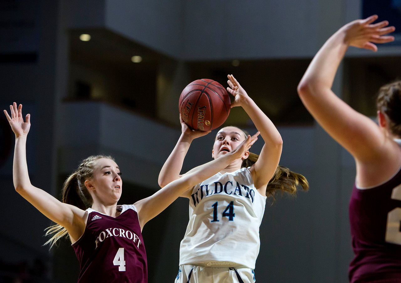 BANGOR, Maine -- 02/22/2017 -- Presque Isle's Emily A. Wheaton (center) puts up a shot past Foxcroft Academy's Alli Bourget (left) and Foxcroft Academy's Grace Bickford during their Class B girls basketball semifinal game at the Cross Insurance Center in Bangor Wednesday. Ashley L. Conti | BDN
