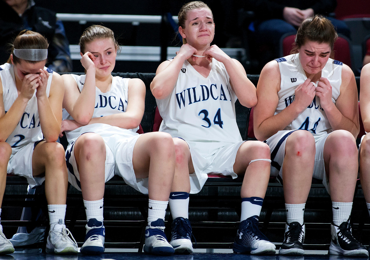 BANGOR, Maine -- 02/22/2017 -- The Presque Isle bench sits dejected as time runs out during their Class B girls basketball semifinal game against Foxcroft Academy at the Cross Insurance Center in Bangor Wednesday. Ashley L. Conti | BDN