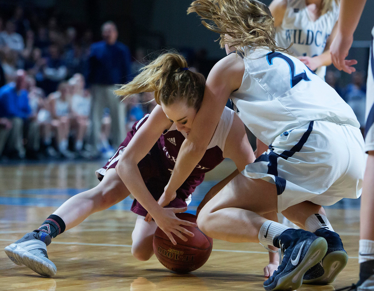 BANGOR, Maine -- 02/22/2017 -- Foxcroft Academy's Alli Bourget (left) dives on a loose ball against Presque Isle's Meg E. Boone during their Class B girls basketball semifinal game at the Cross Insurance Center in Bangor Wednesday. Ashley L. Conti   BDN