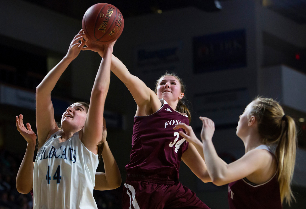 BANGOR, Maine -- 02/22/2017 -- Presque Isle's Skylar J. Vogel (left) is fouled by Foxcroft Academy's Mackenzie Beaudry during their Class B girls basketball semifinal game at the Cross Insurance Center in Bangor Wednesday. Ashley L. Conti | BDN