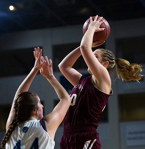 BANGOR, Maine -- 02/22/2017 -- Foxcroft Academy's Abigail Simpson (right) puts up a shot past Presque Isle's Skylar J. Vogel during their Class B girls basketball semifinal game at the Cross Insurance Center in Bangor Wednesday. Ashley L. Conti | BDN