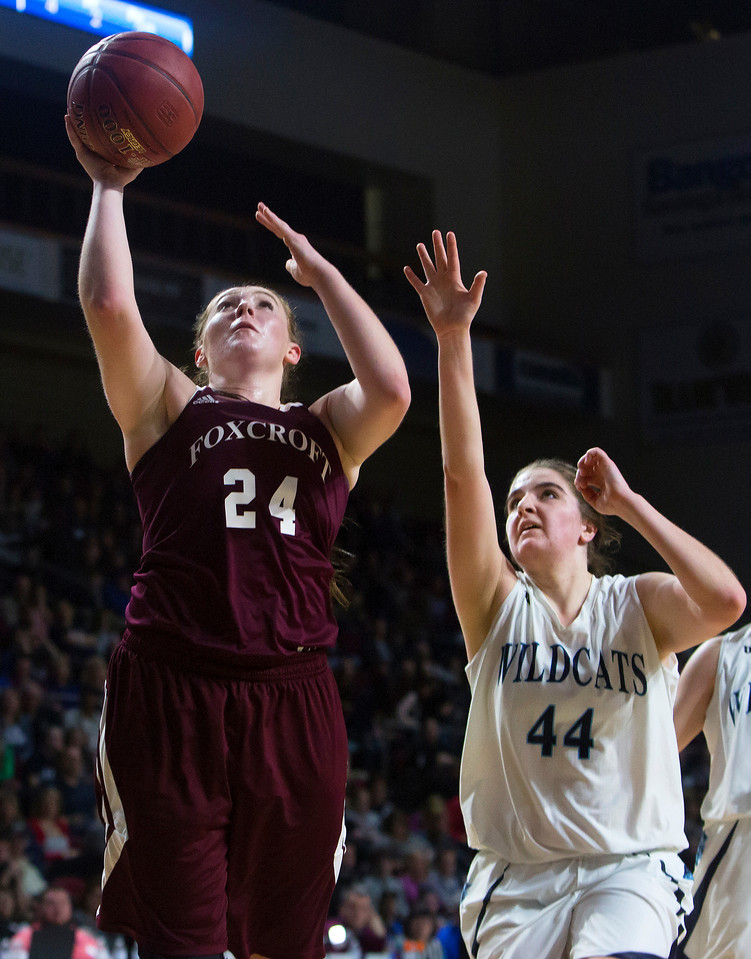 BANGOR, Maine -- 02/22/2017 -- Foxcroft Academy's Grace Bickford (left) goes up for two past Presque Isle's Skylar J. Vogel during their Class B girls basketball semifinal game at the Cross Insurance Center in Bangor Wednesday. Ashley L. Conti | BDN