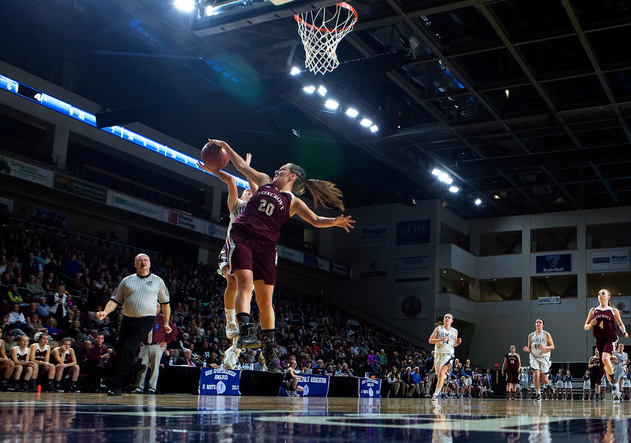 BANGOR, Maine -- 02/22/2017 -- Presque Isle's Madison M. Michaud (left) has her shot blocked by Foxcroft Academy's Kendra Ewer during their Class B girls basketball semifinal game at the Cross Insurance Center in Bangor Wednesday. Ashley L. Conti   BDN