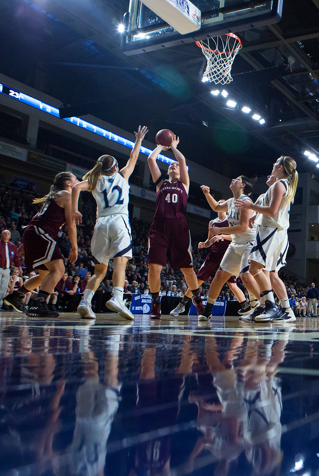 BANGOR, Maine -- 02/22/2017 -- Foxcroft Academy's Abigail Simpson (center) goes up for two past Presque Isle's Madison M. Michaud during their Class B girls basketball semifinal game at the Cross Insurance Center in Bangor Wednesday. Ashley L. Conti | BDN