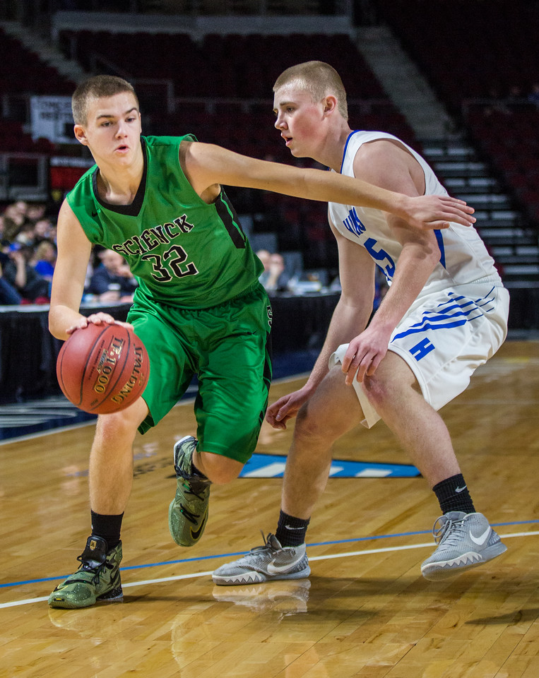 BANGOR, MAINE -- 02/21/2017 --  Schenck's Travis Thompson (left) dribbles past Hodgdon's Wyatt Foster during their Class C North Quarterfinal game at the Cross Insurance Center in Bangor on Tuesday morning. Micky Bedell | BDN