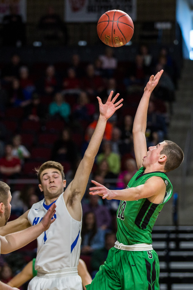 BANGOR, MAINE -- 02/21/2017 -- Schenck's Christopher J. King (right) takes a shot of Hodgdon's Dylan Oliver during their Class C North Quarterfinal game at the Cross Insurance Center in Bangor on Tuesday morning. Micky Bedell | BDN