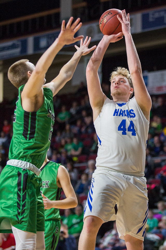 BANGOR, MAINE -- 02/21/2017 --  Schenck's Justin Thompson (left) tries to block a shot from Hodgdon's Kevin McAfee during their Class C North Quarterfinal game at the Cross Insurance Center in Bangor on Tuesday morning. Micky Bedell | BDN