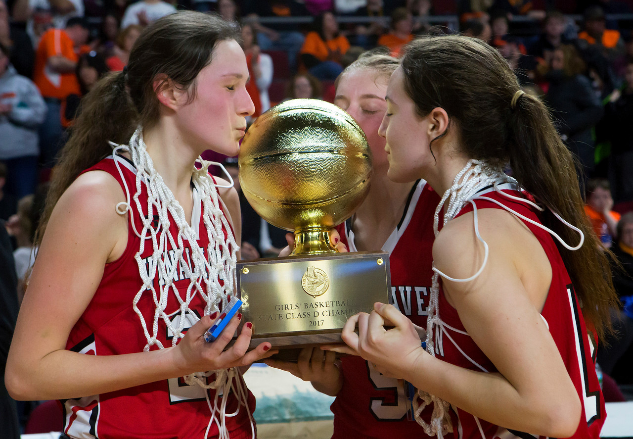 BANGOR, Maine -- 03/04/2017 -- Vinalhaven's Gilleyanne Davis-Oakes (from left), Vinalhaven's Paige A. Dennison, and Vinalhaven's Deja Doughty kiss the golden ball after defeating Shead during their Class D girls basketball state championship at the Cross Insurance Center in Bangor Saturday. Ashley L. Conti | BDN