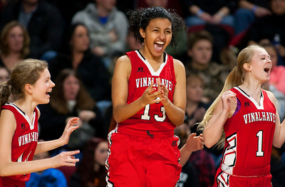 BANGOR, Maine -- 03/04/2017 -- Vinalhaven's Corey Lazaro (from left), Vinalhaven's Rosanna Morel, and Vinalhaven's Hannah Newton celebrate after defeating Shead during their Class D girls basketball state championship at the Cross Insurance Center in Bangor Saturday. Ashley L. Conti | BDN