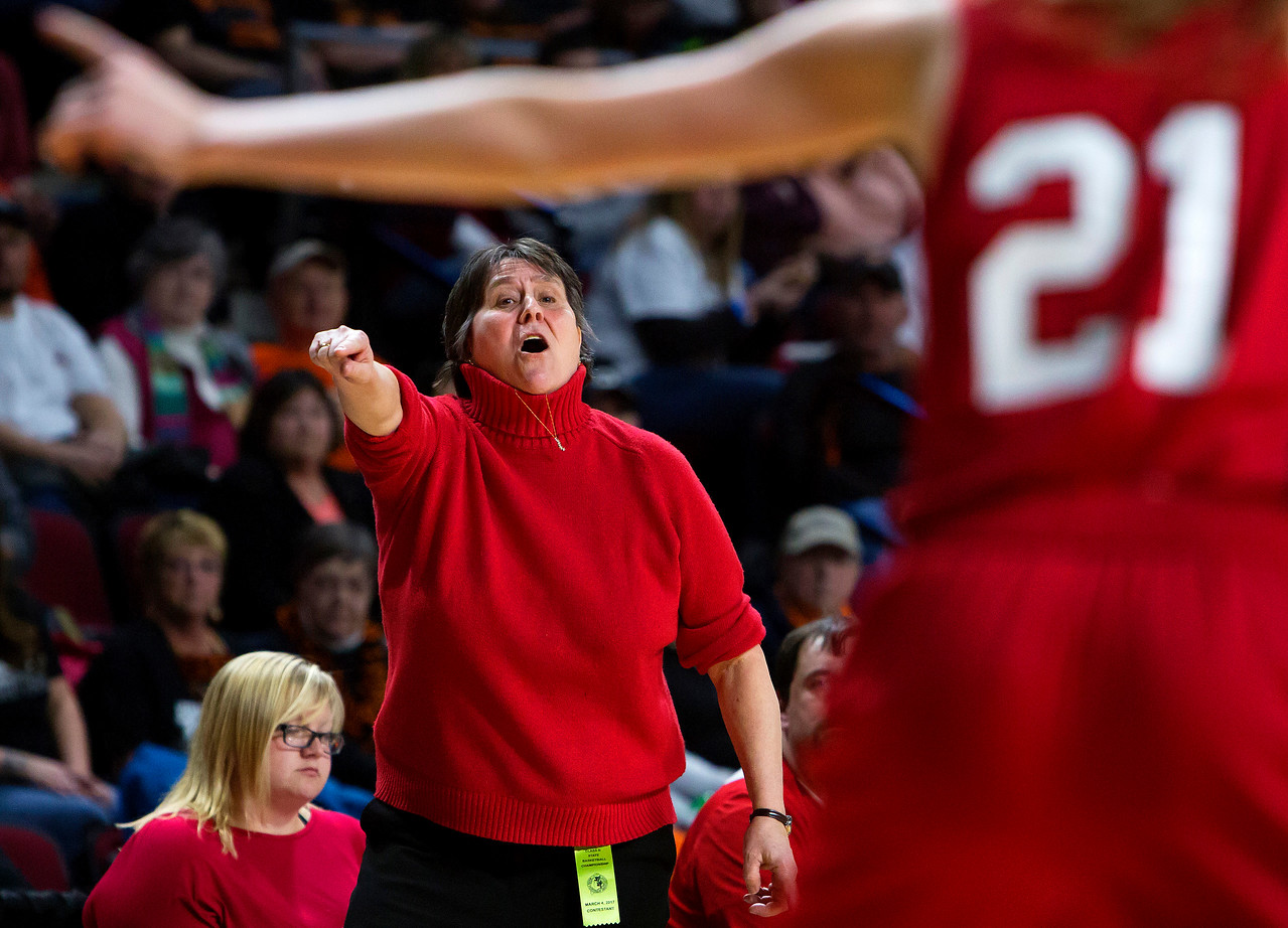 BANGOR, Maine -- 03/04/2017 -- Vinalhaven head coach Sandy Nelson yells instructions to her team during their Class D girls basketball state championship against Shead at the Cross Insurance Center in Bangor Saturday. Ashley L. Conti | BDN