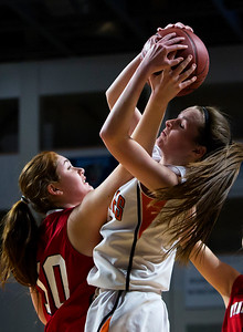 BANGOR, Maine -- 03/04/2017 -- Vinalhaven's Amber Shane (left) battles for a rebound against Shead's Madison Greenlaw during their Class D girls basketball state championship at the Cross Insurance Center in Bangor Saturday. Ashley L. Conti | BDN