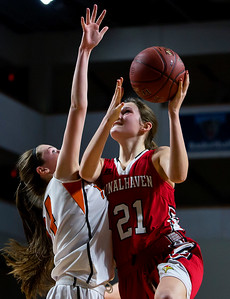 BANGOR, Maine -- 03/04/2017 -- Vinalhaven's Gilleyanne Davis-Oakes (right) drives to the land past Shead's Madison Greenlaw during their Class D girls basketball state championship at the Cross Insurance Center in Bangor Saturday. Ashley L. Conti | BDN
