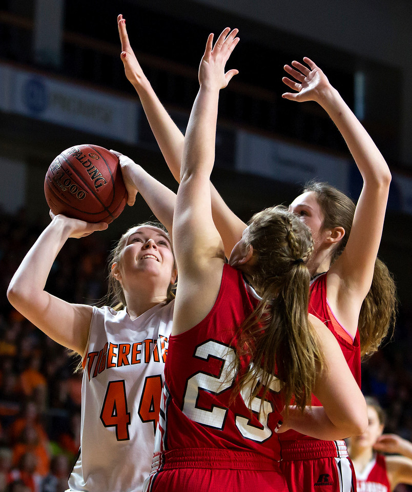 BANGOR, Maine -- 03/04/2017 -- Shead's Cassidy Wilder (left) puts up a shot past Vinalhaven's Cheyenne P. Bickford (center) and Vinalhaven's Gilleyanne Davis-Oakes during their Class D girls basketball state championship at the Cross Insurance Center in Bangor Saturday. Ashley L. Conti | BDN