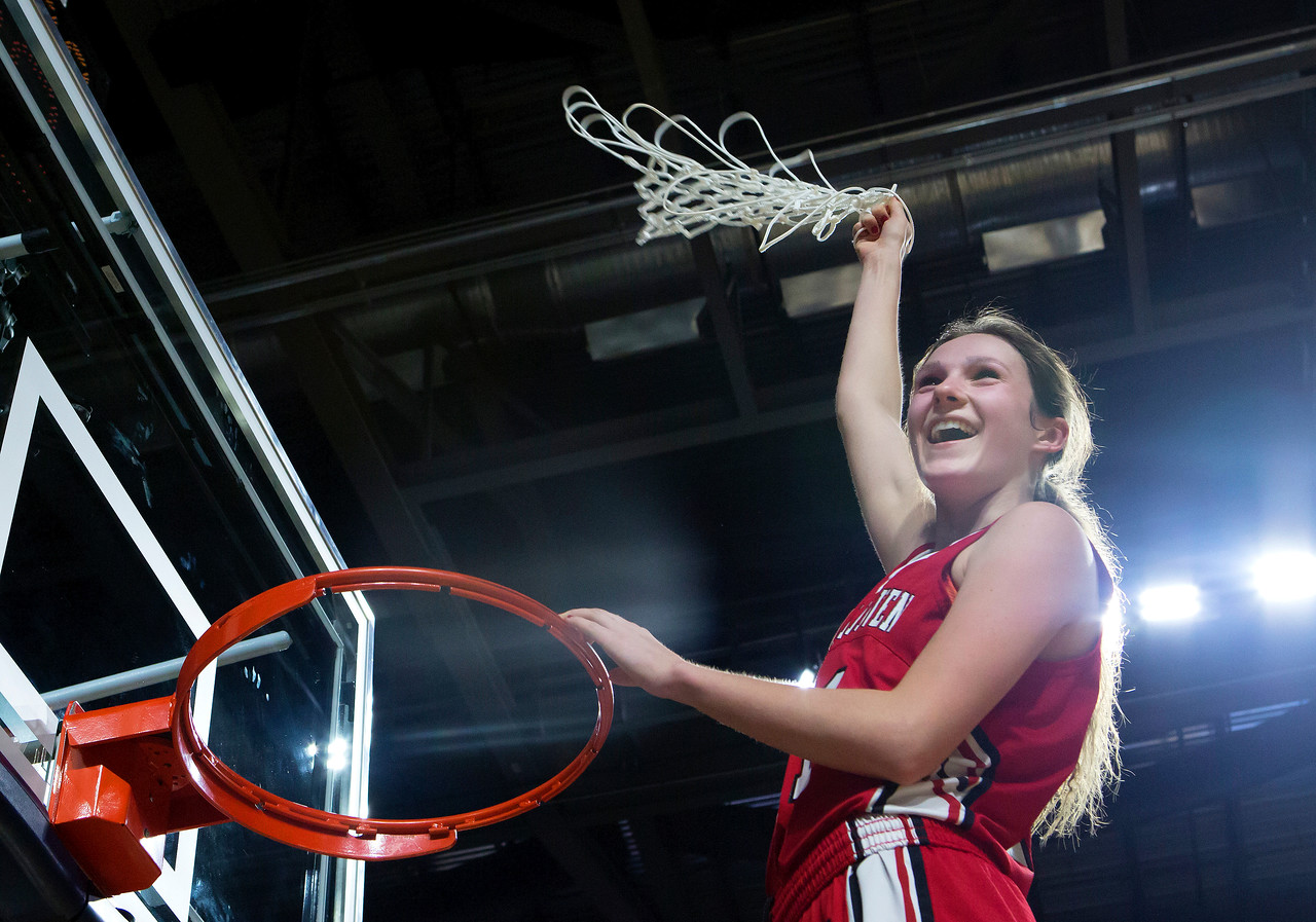 BANGOR, Maine -- 03/04/2017 -- Vinalhaven's Gilleyanne Davis-Oakes swings the net around her head after defeating Shead during their Class D girls basketball state championship at the Cross Insurance Center in Bangor Saturday. Ashley L. Conti | BDN