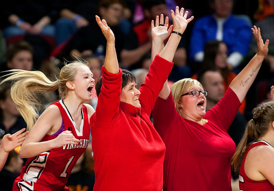 BANGOR, Maine -- 03/04/2017 -- Vinalhaven celebrates after defeating Shead during their Class D girls basketball state championship at the Cross Insurance Center in Bangor Saturday. Ashley L. Conti | BDN