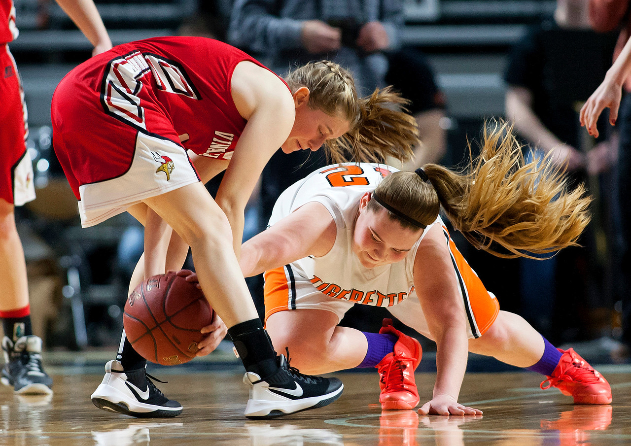 BANGOR, Maine -- 03/04/2017 -- Vinalhaven's Paige A. Dennison (left) and Shead's Halle Sullivan battle for a loose ball during their Class D girls basketball state championship at the Cross Insurance Center in Bangor Saturday. Ashley L. Conti   BDN