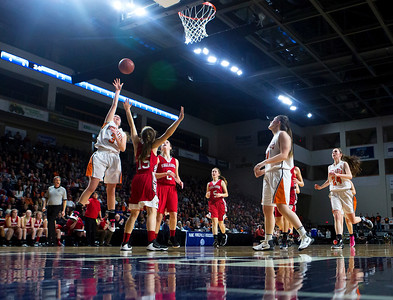 BANGOR, Maine -- 03/04/2017 -- Shead's Holly Preston (left) drives up for two past Vinalhaven's Deja Doughty during their Class D girls basketball state championship at the Cross Insurance Center in Bangor Saturday. Ashley L. Conti | BDN